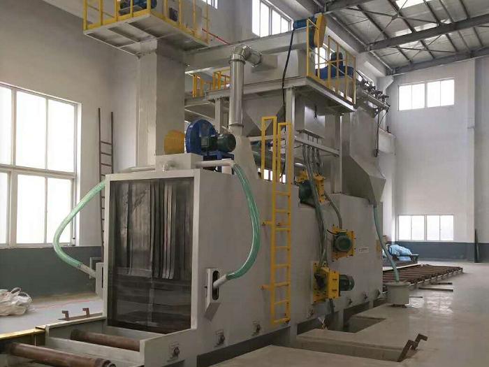 辽宁造纸厂客户采购通过式抛丸清理机,设备环保无污染!